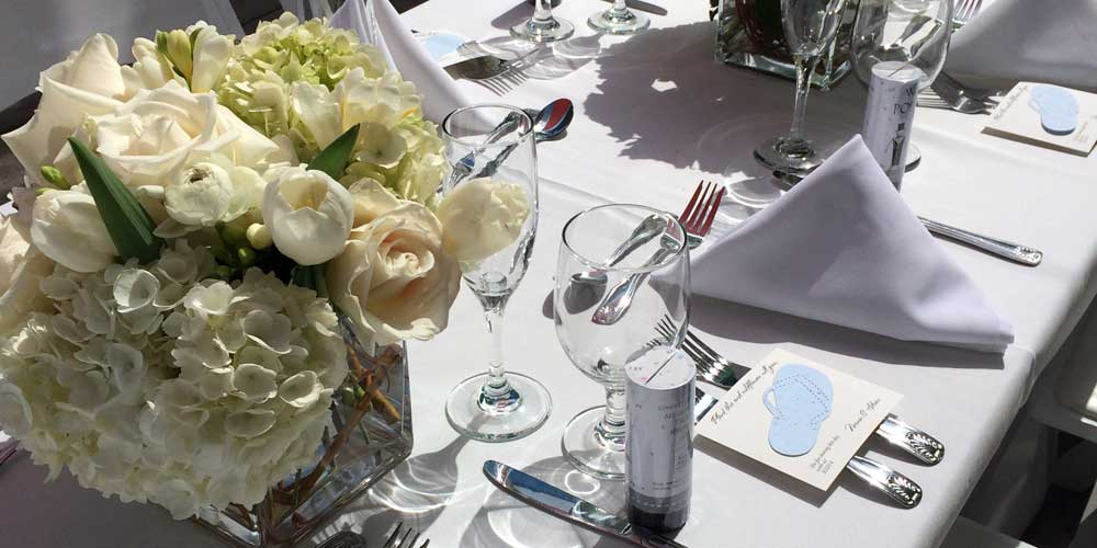 Wedding catering service table setting with glassware
