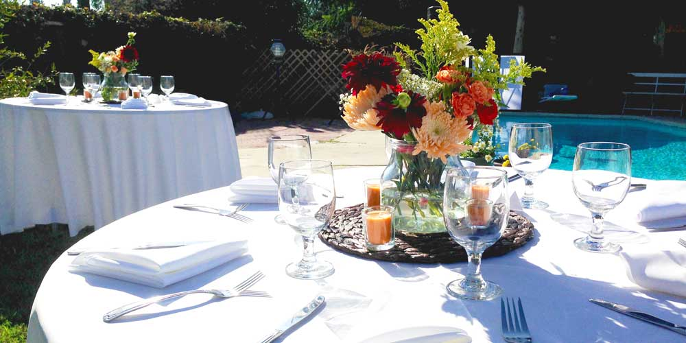 Poolside table setting for Rise & Shine wedding catering event
