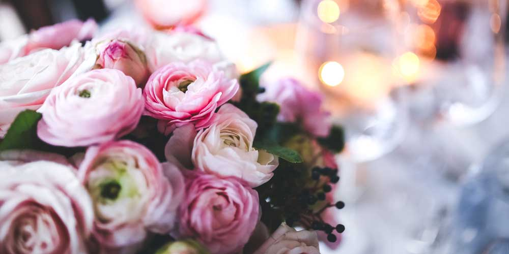 Custom floral arrangement for wedding catering service table centerpiece