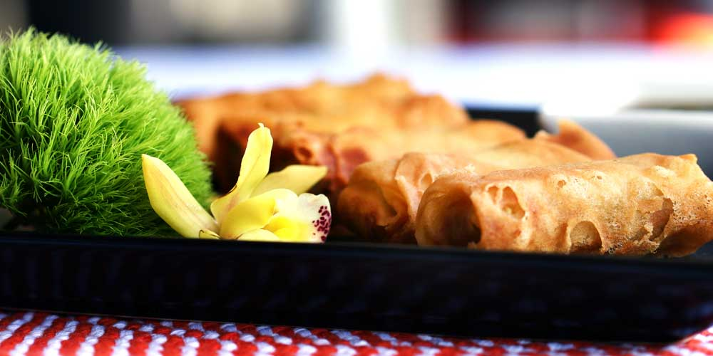 Eggrolls on a platter as part of Rise & Shine's corporate catering service