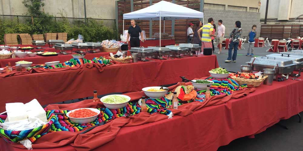 Buffet table service as part of Rise & Shine's taco cart catering