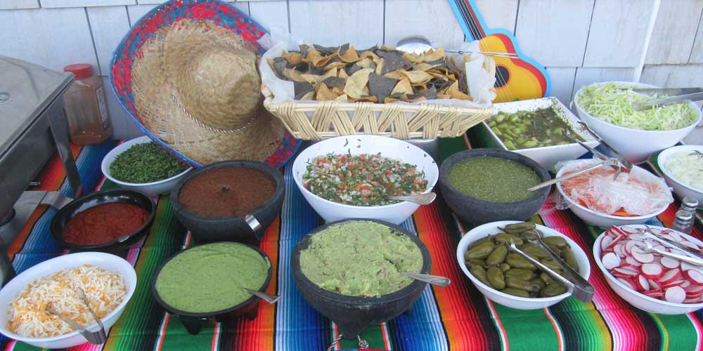 Taco cart catering condiments table